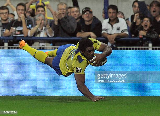 Clermont's Fidji winger Napolioni Nalaga scores a try during the French Top 14 rugby match between ASM Clermont Auvergne and CA Brive on October 26...