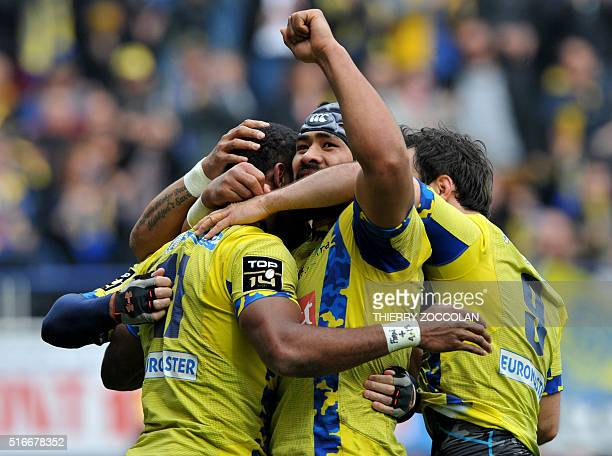 Clermont's Fijian winger Alivereti Raka celebrates with teammates after scoring a try during the French Top 14 rugby union match between Clermont and...