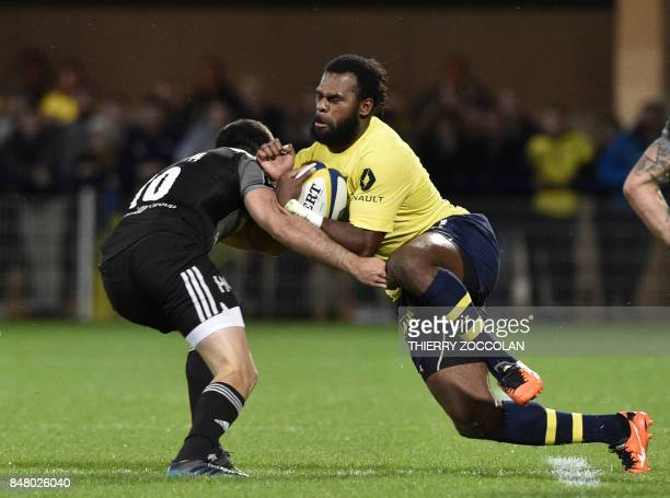Clermont's Fijian winger Alivereti Raka fights for the blal with Brive's French flyhalf Nicolas Bezy during the French rugby union match between ASM...