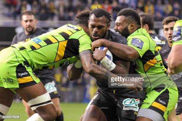 Clermont's Fijian winger Alivereti Raka is tackled during the European Rugby Champions Cup match ASM Clermont Auvergne vs Northampton Saints at the...