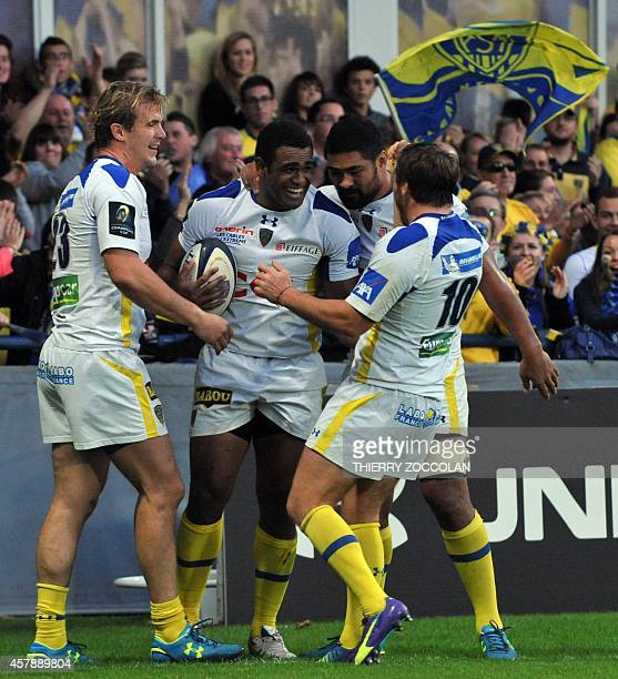Clermont's Fijian winger Napolioni Nalaga is congratulated by his teammates after scoring a try during the European Champions Cup rugby union match...