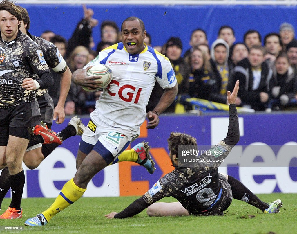 Clermont's Fijian winger Sitiveni Sivivatu (2nd R) escapes the tackle from Montpellier's French scrum-half Benoit Paillaugue (R) during the European Cup rugby union match ASM Clermont-Auvergne vs Montpellier Herault Rugby at the Marcel Michelin stadium on April 6, 2013 in Clermont-Ferrand, central France. AFP PHOTO/THIERRY ZOCCOLAN