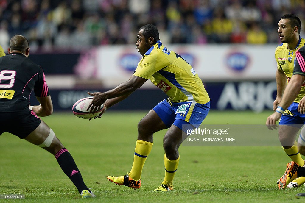 Clermont's Fijian winger Sitiveni Sivivatu passes the ball during the French Top 14 rugby Union match Stade Francais vs Clermont on September 8, 2013 at the Jean Bouin stadium in Paris.