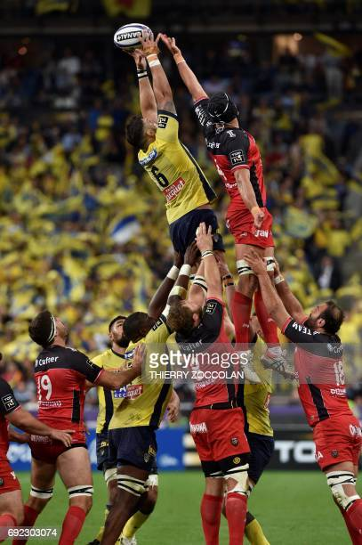 Clermont's flanker Damien Chouly grabs the ball in a lineout during the French Top 14 rugby union final match Clermont vs Toulon on June 4 2017 at...