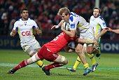 Clermont's French centre Aurelien Rougerie is tackled by Munster's Irish flanker Peter O'Mahony during the European Champions Cup rugby union match...