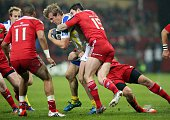 Clermont's French centre Aurelien Rougerie is tackled during a European Champions Cup rugby union match between Munster and ASM Clermont Auvergne at...