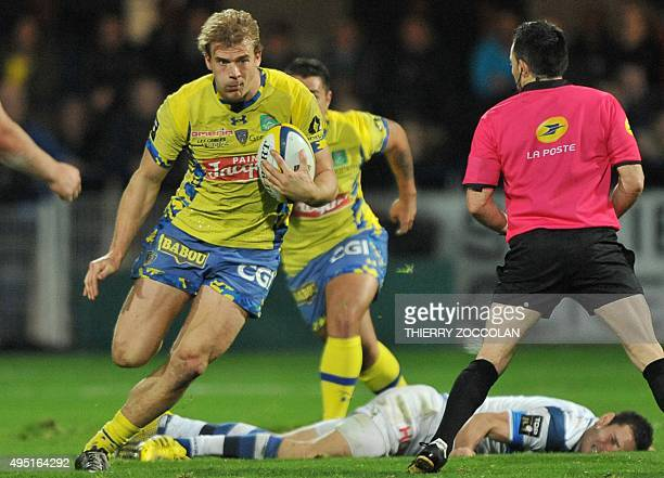 Clermont's French centre Aurelien Rougerie rides the ball during the French Union Rugby match between ASM Clermont and Castres Olympique on October...