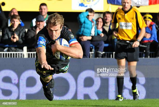 Clermont's French centre Aurelien Rougerie scores a try during the European Champions Cup rugby match Clermont vs Ospreys at the Michelin stadium in...