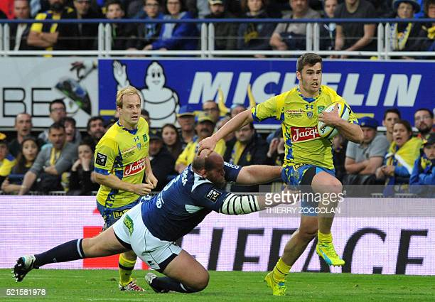 Clermont's French centre Damian Penaud runs with the ball during the French Union Rugby match ASM Clermont vs Agen at the Michelin stadium in...