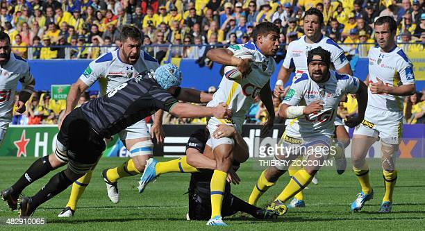Clermont's French centre Wesley Fofana runs with the ball during the European Cup rugby union match ASM ClermontAuvergne vs Leicester Tigers at the...
