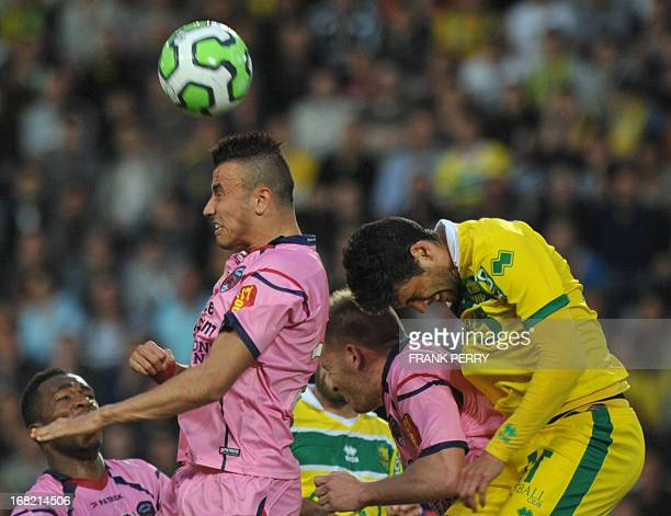 Clermont's French defender Romain Saiss vies with Nantes' French defender Gabriel Cichero during a French L2 football match between Nantes and...