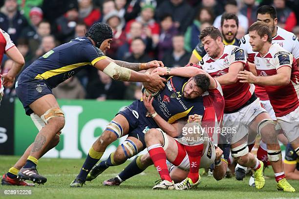 Clermont's French flanker Damien Chouly is tackled during the European Rugby Champions Cup rugby union match between Ulster and Clermont Auvergne at...