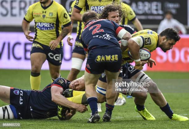 Clermont's French flanker Damien Chouly vies with Grenoble's French hooker Arnaud Heguy and Grenoble's Australian lock Henry Vanderglas during the...