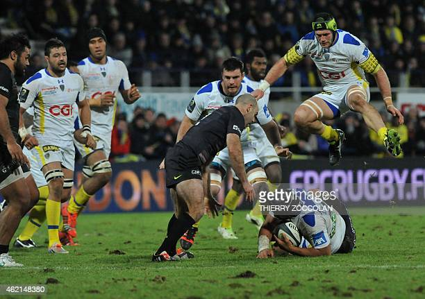 Clermont's French flanker Julien Bonnaire jumps over Clermont's New Zealander flanker Fritz Lee during the European Champions Cup rugby union match...