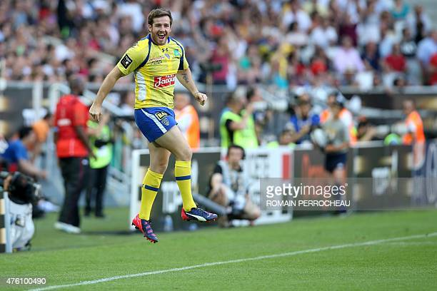 Clermont's french fly half Camille Lopez celebrates at the end of the French Top 14 semifinal rugby union match between Toulouse and Clermont on June...