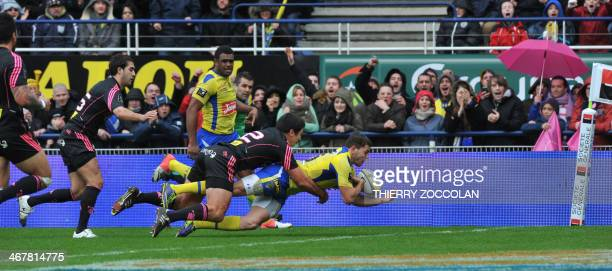 Clermont's French fullback JeanMarcellin Butin fails to score a try during the French Top 14 rugby Union match ASM ClermontAuvergne vs Stade Francais...