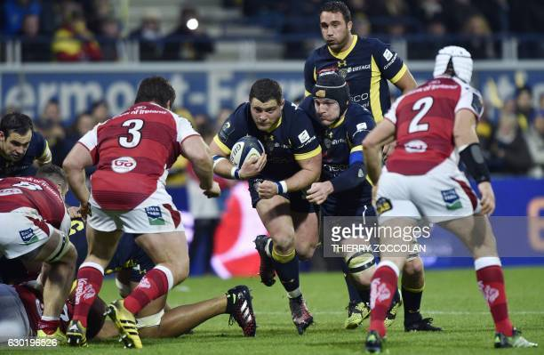 Clermont's French hooker Benjamin Kayser runs with the ball during a rugby union European Cup match between Clermont and Ulster at the Michelin...