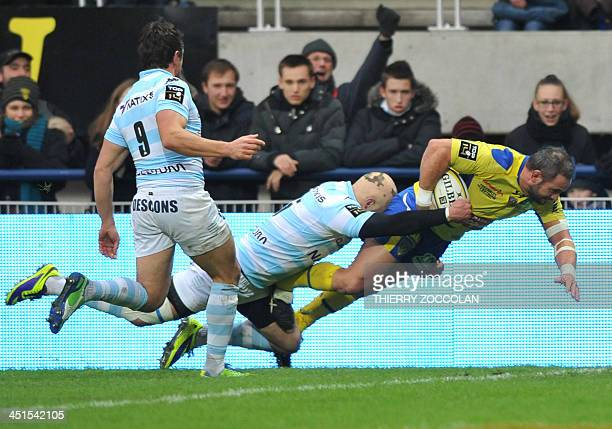 Clermont's French hooker Benoit Cabello jumps to score a try during the French Top 14 rugby Union match ASM Clermont Auvergne vs Racing Metro 92 on...