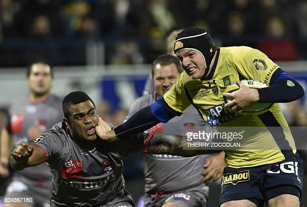 TOPSHOT Clermont's French lock Arthur Iturria runs to score a try during the French Top 14 Rugby Union match between ASM Clermont and Lyon OU at...