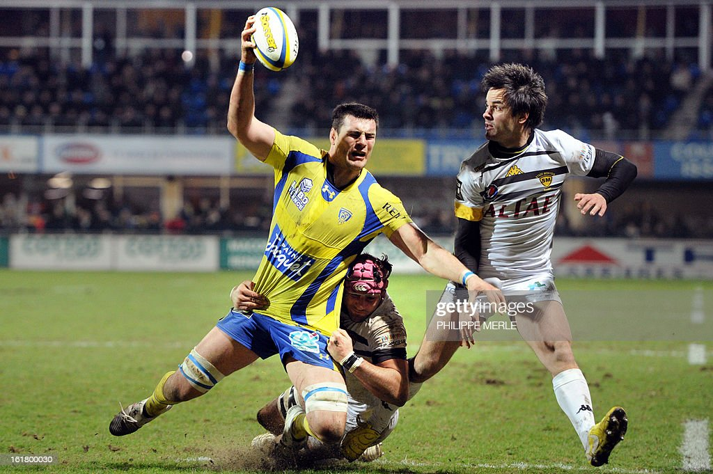 Clermont's French lock Loic Jacquet (L) is tackled during the French Top 14 rugby union match between Clermont-Ferrand and Mont-de-Marsan on February 16, 2013 at the Marcel Michelin Stadium in Clermont-Ferrand.
