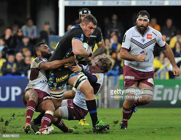 Clermont's French lock Paul Jedrasiak is tackled during the European Champions Cup rugby union match Clermont vs BeglesBordeaux at the Michelin...
