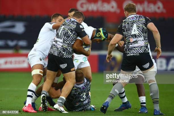Clermont's French lock Sebastien Vahaamahina holds the ball during the European Rugby Champions Cup rugby union round 1 pool match between Ospreys...