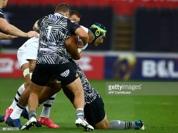Clermont's French lock Sebastien Vahaamahina is tackled during the European Rugby Champions Cup rugby union round 1 pool match between Ospreys and...