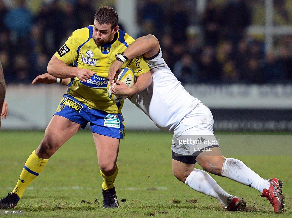 Clermont's French prop Raphael Chaume (L) vies with Mont-de-Marsan's Tongan hooker Ephraim Taukafa during the French Top 14 rugby union match Clermont-Ferrand vs Mont-de-Marsan on February 16, 2013 at the Marcel Michelin stadium in Clermont-Ferrand.