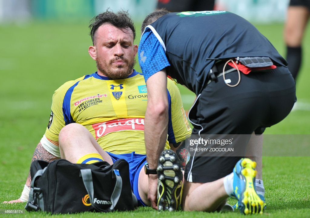 Clermont's French prop <a gi-track='captionPersonalityLinkClicked' href=/galleries/search?phrase=Thomas+Domingo&family=editorial&specificpeople=4651174 ng-click='$event.stopPropagation()'>Thomas Domingo</a> (L) reacts after being injured during the French Top 14 rugby union match ASM Clermont vs Oyonnax at the Michelin stadium in Clermont-Ferrand, central France, on April 11, 2015. AFP PHOTO / THIERRY ZOCCOLAN