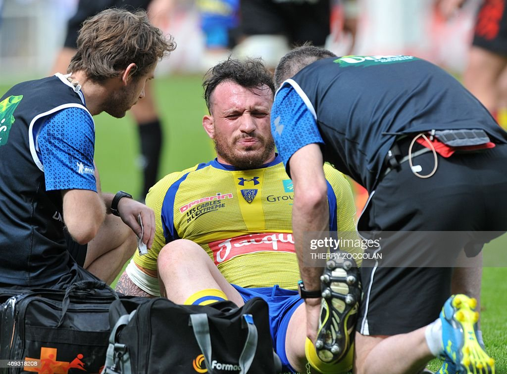 Clermont's French prop <a gi-track='captionPersonalityLinkClicked' href=/galleries/search?phrase=Thomas+Domingo&family=editorial&specificpeople=4651174 ng-click='$event.stopPropagation()'>Thomas Domingo</a> (C) reacts after being injured during the French Top 14 rugby union match ASM Clermont vs Oyonnax at the Michelin stadium in Clermont-Ferrand, central France, on April 11, 2015.