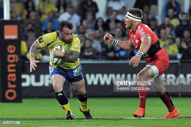 Clermont's French prop Thomas Domingo runs the ball despite of Toulon South African flanker Gerard Vosloo during the French Union Rugby match between...