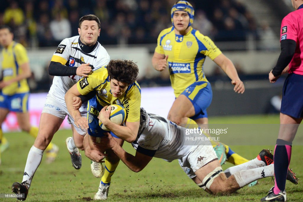 Clermont's French scrum-half David Skrela (C) is tackled during the French Top 14 rugby union match between Clermont-Ferrand and Mont-de-Marsan on February 16, 2013 at the Marcel Michelin stadium in Clermont-Ferrand.