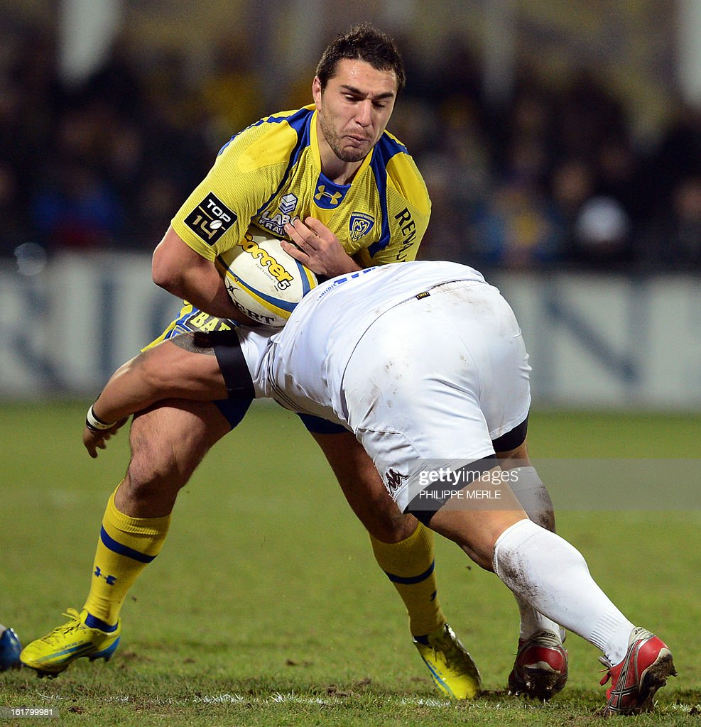 Clermont's French scrum-half Ludovic Radosavljevic (L) is tackled by Mont-de-Marsan's Tongan hooker Ephraim Taukafa during the French Top 14 rugby union match between Clermont-Ferrand and Mont-de-Marsan on February 16, 2013 at the Marcel Michelin Stadium in Clermont-Ferrand.