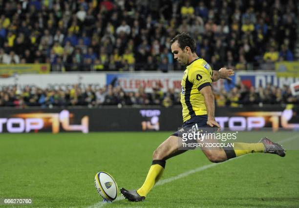 Clermont's French scrumhalf Morgan Parra hits a penalty kick during the French Top 14 rugby union match between Clermont and Brive at the Michelin...