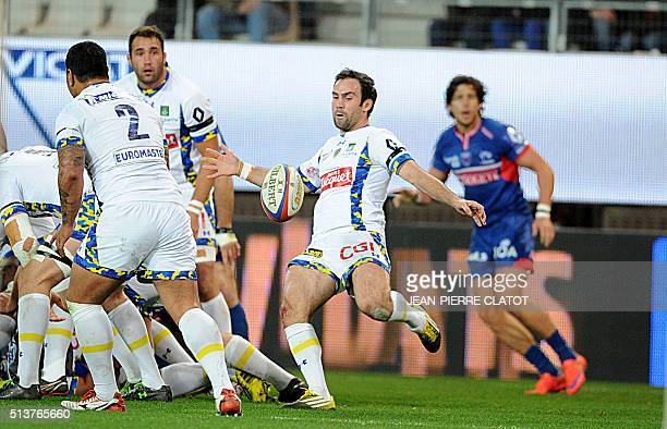 Clermont's French scrumhalf Morgan Parra kicks the ball out of a scrum during the French Top 14 rugby union match Grenoble vs Clermont Auvergne on...