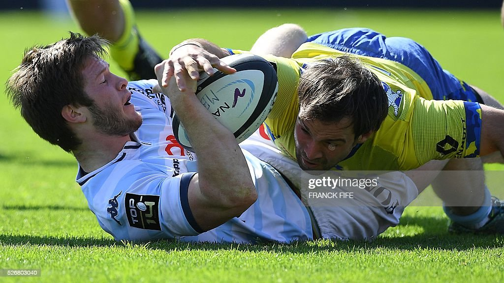 Clermont's French scrumhalf Morgan Parra tackles Racing 92 French right wing Louis Dupichot during the French Top 14 rugby union match between Racing...