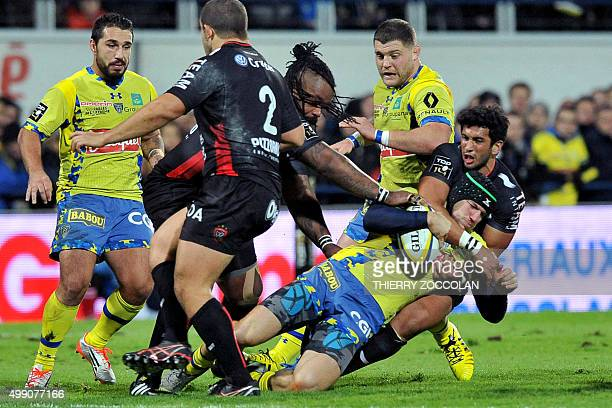 Clermont's French winger Adrien Plante is tackled during the French Top 14 rugby union match between ASM Clermont and RC Toulon at the Michelin...