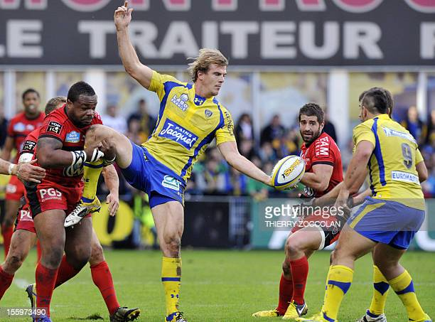 Clermont's French winger Aurelien Rougerie passes the ball during the French Top 14 rugby Union match ASM Clermont Auvergne vs RCT Toulon on November...