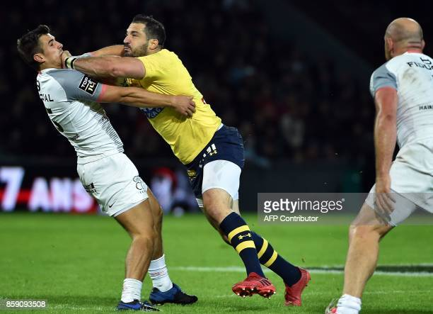 Clermont's fullback Scott Spedding tackles Toulouse's Thomas Ramos during the French Top 14 rugby union match between Stade Toulousain and Clermont...