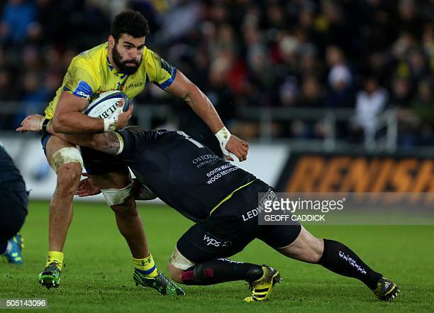 Clermont's Georgian flanker Viktor Kolelishvili is tackled by Ospreys' Welsh prop Paul James during the European Rugby Champions Cup group stage...