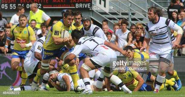 Clermont's lock Jamie Cudmore runs with the ball during the French Top 14 rugby union match Brive versus Clermont on August 23 2014 at the Amede...