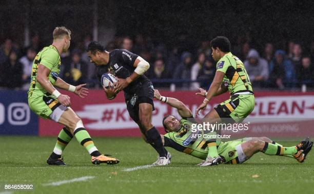 Clermont's New Zealander winger Peter Betham is tackled by Northampton's scrumhalf Ben Foden during the European Rugby Champions Cup match ASM...