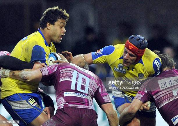 Clermont's number eight Sione Lauaki is tackled by Bourgoin's players during the French Top 14 rugby union match ASM Clermont Auvergne vs CS Bourgoin...