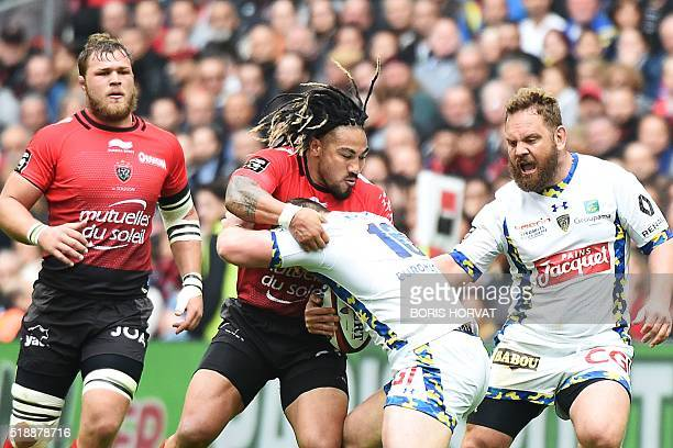 TOPSHOT Clermont's Patricio Fernandez vies for the ball with RC Toulon's New Zealand centre Maa Nonu during the French Top 14 rugby union match...
