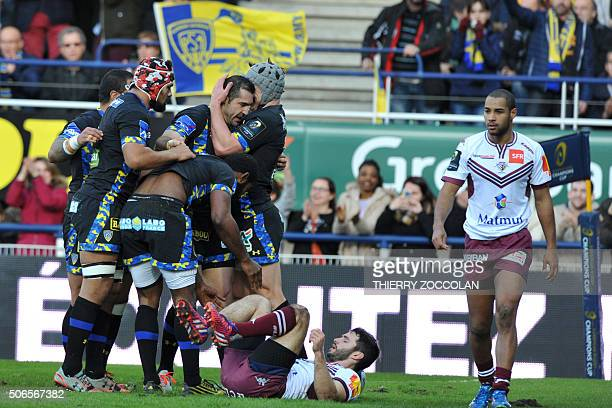 Clermont's players celebrate after their second try during the European Rugby Champions Cup rugby union match between ASM Clermont Auvergne and Union...