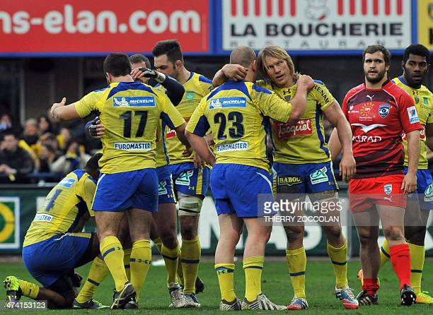 Clermont's players celebrate after their team's victory in the French Top 14 rugby union match between Clermont Auvergne and Montpellier Herault...
