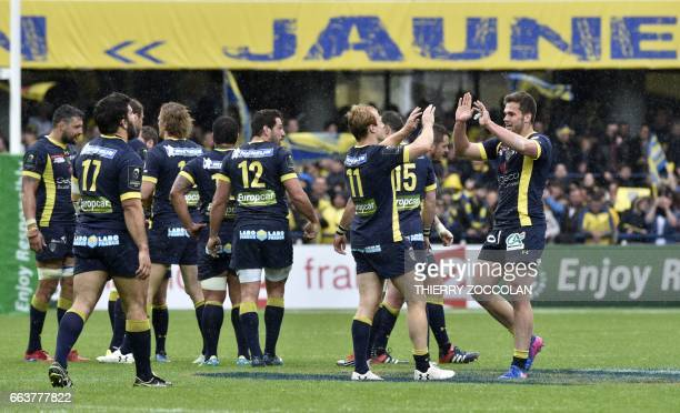 Clermont's players celebrate at the end of the European Champions Cup match between Clermont and Toulon at Michelin Stadium in ClermontFerrand on...