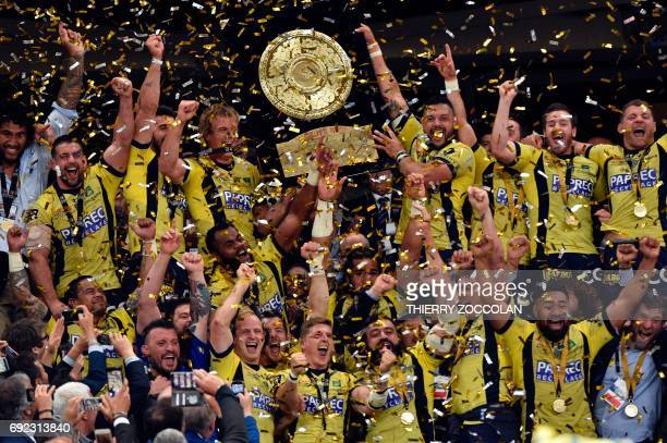 Clermont's players celebrate with the trophy at the end of the French Top 14 rugby union final match Clermont vs Toulon on June 4 2017 at the Stade...