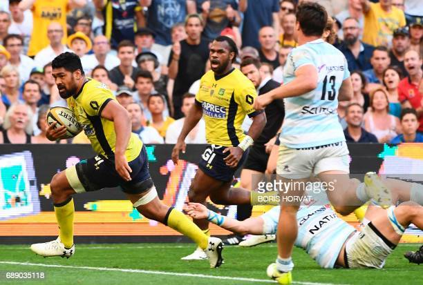 Clermont's Samoan back row Fritz Lee runs as he scores a try during the French Top 14 rugby union semifinal match between Clermont and Racing 92 on...