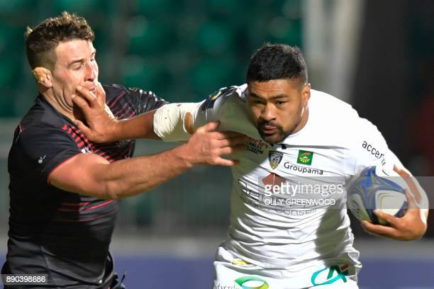 Clermont's Samoan number 8 Fritz Lee hands off Saracens' English number 8 Jackson Wray during the European Rugby Champions Cup rugby union match...